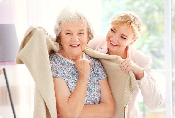 caregiver assisting her patient